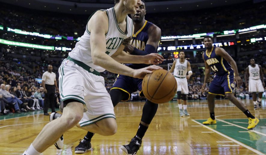 Boston Celtics center Tyler Zeller, front, drives against Indiana Pacers center Roy Hibbert (55) during the first half of an NBA basketball game in Boston Wednesday, April 1, 2015. (AP Photo/Elise Amendola)