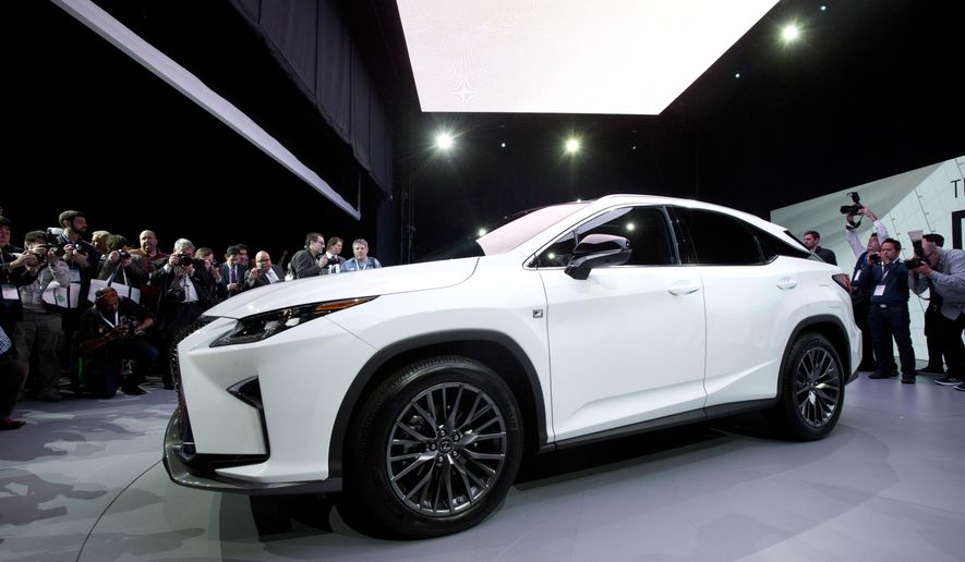 The 2016 Lexus RX is introduced at the New York International Auto Show, Wednesday, April 1, 2015. (AP Photo/Mark Lennihan)