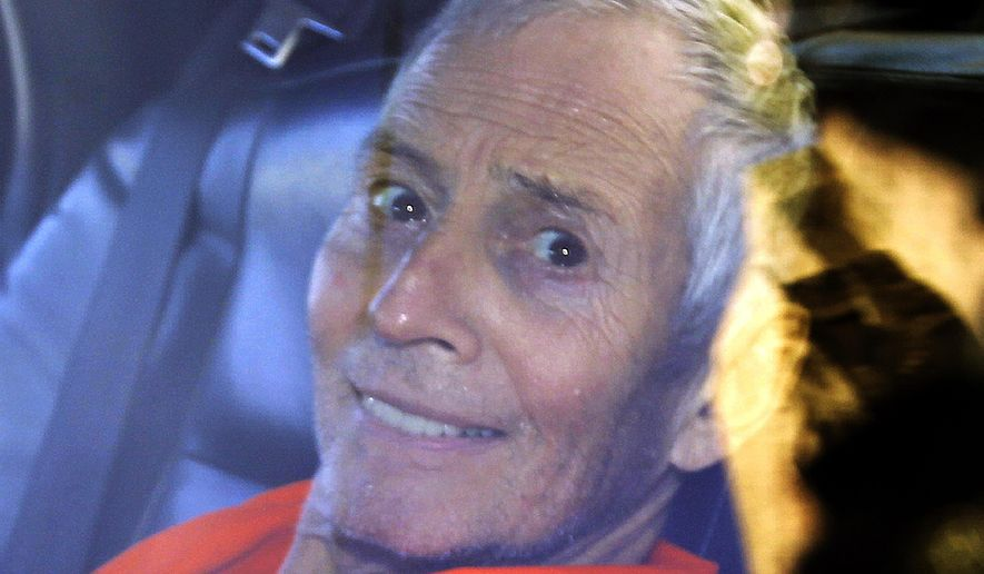 In this Tuesday, March 17, 2015, file photo, millionaire Robert Durst is escorted from Orleans Parish Criminal District Court to the Orleans Parish Prison after his arraignment in New Orleans. (AP Photo/Gerald Herbert, File)