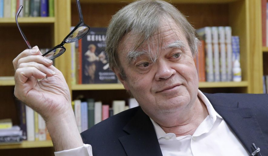"FILE - In this April 29, 2014 Garrison Keillor pauses in his St. Paul, Minn., office. Keillor, the host of ""A Prairie Home Companion,"" is offering $5,000 in prize money for the annual poetry contest sponsored by Garrison Keillor's St. Paul bookstore. (AP Photo/Ann Heisenfelt, File)"