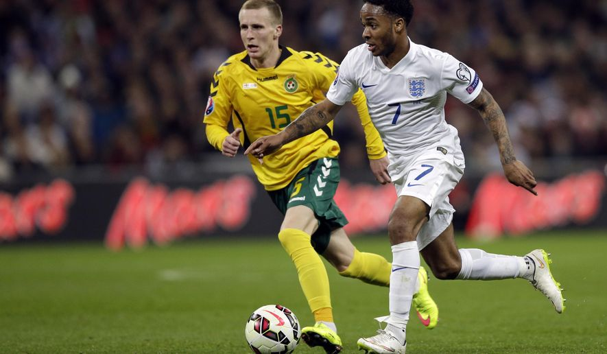 England's Raheem Sterling, right, is challenged by Lithuania's Karolis Chvedukas during the Euro 2016 Group E qualifying soccer match between England and Lithuania at Wembley Stadium in London, Friday, March 27, 2015. (AP Photo/Matt Dunham)
