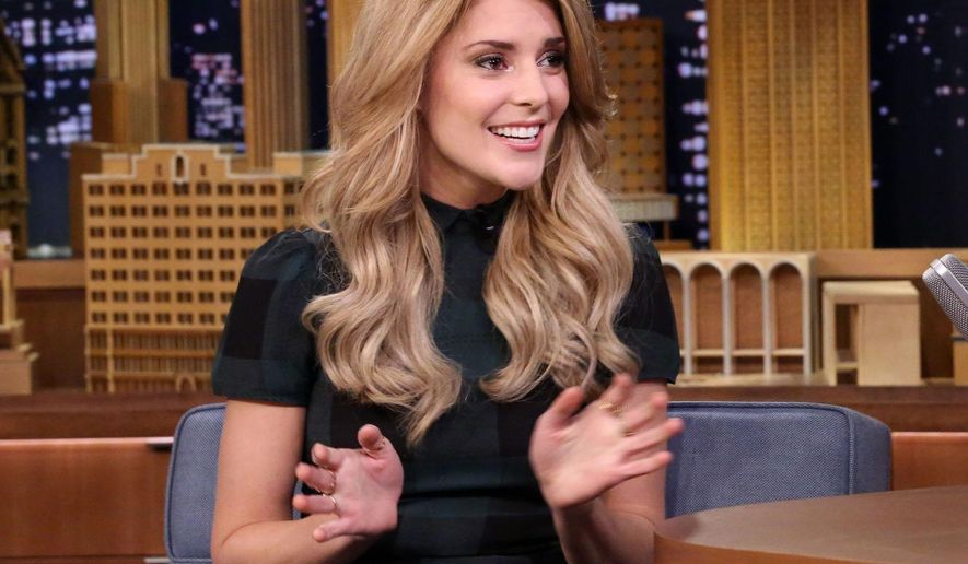 """In this March 25, 2015 photo released by NBC, comedian Grace Helbig speaks during an interview with host Jimmy Fallon on """"The Tonight Show with Jimmy Fallon,"""" in New York. Helbig's new show, """"The Grace Helbig Show"""" premieres on E! Entertainment on Friday at 10:30 p.m. EDT. (AP Photo/NBC, Douglas Gorenstein)"""