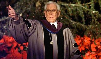 "FILE - In this Dec. 24, 1997, file photo, Rev. Robert H. Schuller delivers one of seven candlelight Christmas Eve services from the Crystal Cathedral pulpit in Garden Grove, Calif. Schuller, the Southern California televangelist who brought his message of ""possibility thinking"" to millions, died early Thursday, April 2, 2015, in California. He was 88. (AP Photo/Kevork Djansezian, File)"