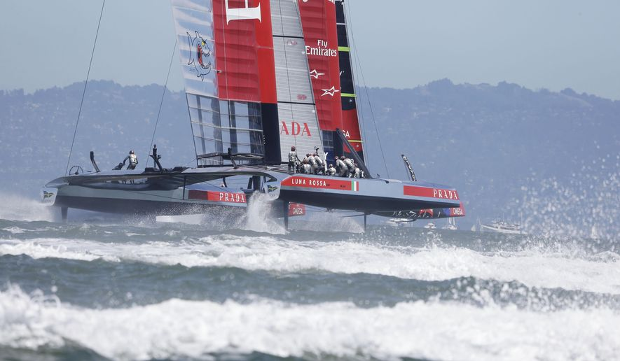 In this Aug. 24, 2013 file photo Luna Rossa Challenge of Italy heads for the second mark during the seventh race of their America's Cup challenger series final sailing event against Emirates Team New Zealand, in San Francisco. Italian team Luna Rossa has announced Thursday, April 2, 2015 it will withdraw from the America's Cup after teams voted to reduce the size of boats to be sailed in the 2017 regatta in Bermuda. (AP Photo/Eric Risberg, File)