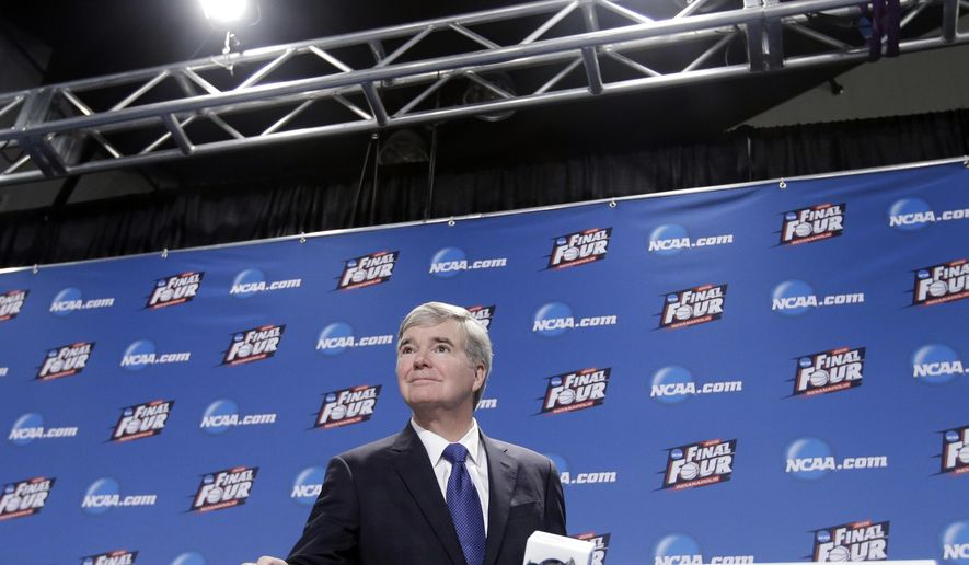 NCAA President Mark Emmert arrives for a news conference at the Men's Final Four college basketball tournament Thursday, April 2, 2015, in Indianapolis. (AP Photo/Darron Cummings)