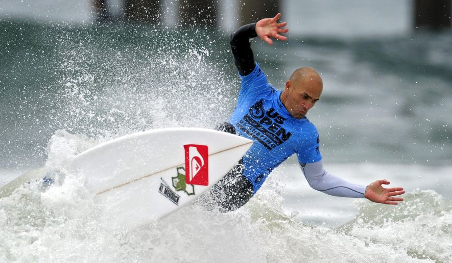 FILE - In this Aug. 7, 2011 file photo, Kelly Slater competes during the semifinals of the U.S. Open of Surfing, in Huntington Beach, Calif.  Kelly Slater caused a stir in the surfing world on Thursday, April 2, 2011, when the 11-time world champion suggested in an Instagram post that the Bells Beach event in Australia might be his last before retiring.  What still hadn't been determined was whether Slater was playing a late April Fools' Day prank from the event about 100 kilometers (60 miles) southwest of Melbourne. (AP Photo/Mark J. Terrill, File)
