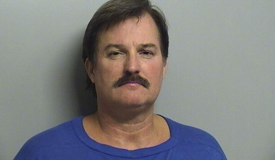 FILE - This undated file booking photo provided by the Tulsa County Sheriff's Office shows Shannon Kepler. Kepler, a Tulsa police officer, has pleaded not guilty to first-degree murder in the off-duty shooting death of his daughter's boyfriend. (AP Photo/Tulsa County Sheriff's Office, File)