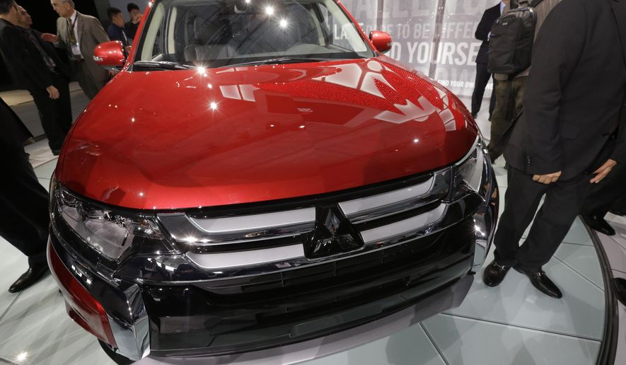The Mitsubishi Outlander is presented at the New York International Auto Show, Thursday, April 2, 2015, in New York.  (AP Photo/Mary Altaffer)