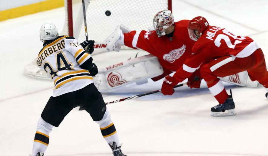 Boston Bruins center Carl Soderberg (34) scores against Detroit Red Wings goalie Petr Mrazek during the third period of an NHL hockey game in Detroit on Thursday, April 2, 2015. (AP Photo/Paul Sancya)