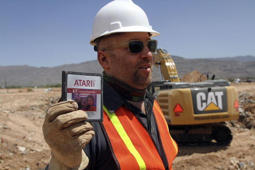 "FILE - In this April 26, 2014 file photo, film director Zak Penn shows a box of a decades-old Atari ""E.T. the Extra-Terrestrial"" game found in a dumpsite in Alamogordo, N.M. A documentary on Atari's decline and a decades-old urban legend on the secret dumping of the ""E.T."" game in the New Mexico desert is airing on Netflix. ""Atari: Game Over"" was released on the streaming service late Wednesday, April 1, 2015, and details the demise of gaming giant Atari.   (AP Photo/Juan Carlos Llorca, File)"