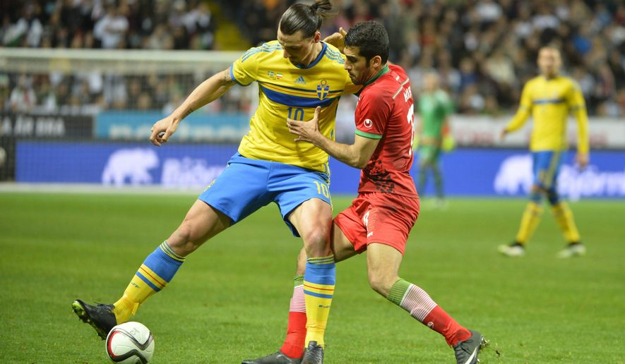 Sweden's Zlatan Ibrahimovic, left, battles for the ball with Iran's Vahid Amiri during their international friendly soccer match at in Stockholm, Sweden, Tuesday March 31, 2015. (AP Photo/Henrik Montgomery, TT) **  SWEDEN OUT  **