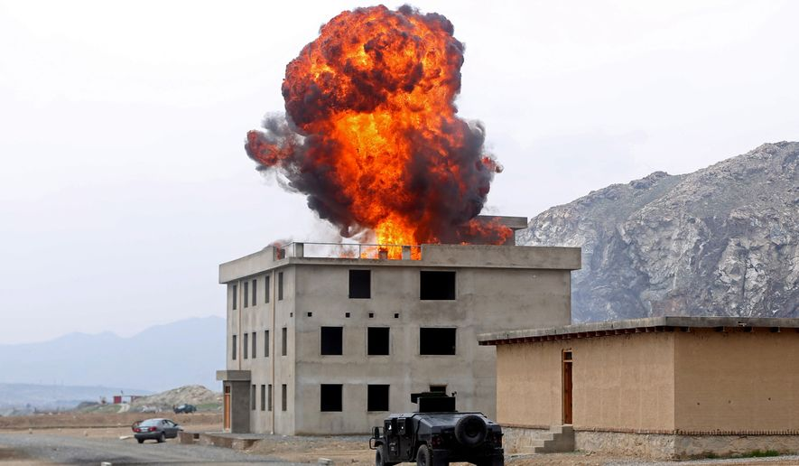 Smoke rises after an explosion during a military exercise in Kabul, Afghanistan, Thursday, April 2, 2015. Afghanistan's security forces took over full responsibility for the country's security on Jan. 1, 2015. (AP Photo/Massoud Hossaini)