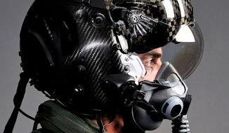 "The F-35 Lightning II pilot helmet can ""see"" through the plane. Cameras allow a pilot to view the world below the aircraft when he looks down instead of the inside of the cockpit. (Image: Lockheed Martin)"