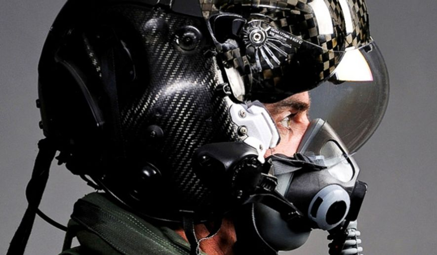 """The F-35 Lightning II pilot helmet can """"see"""" through the plane. Cameras allow a pilot to view the world below the aircraft when he looks down instead of the inside of the cockpit. (Image: Lockheed Martin)"""