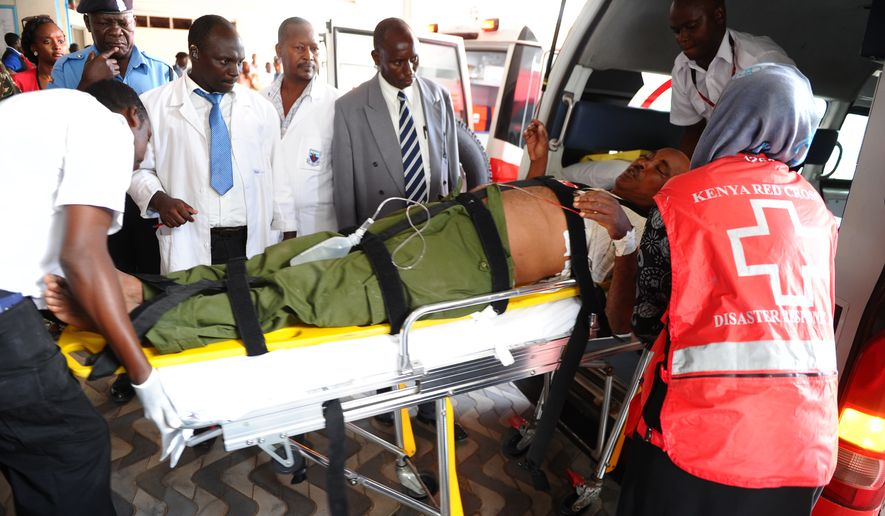 Medics help an injured person at Kenyatta National Hospital in Nairobi, Kenya, Thursday, April , 2, 2015 , after an attack by gunmen at Garissa University College. Al-Shabab gunmen targeted Christians, killing at least 15 people and wounding 60 others. (AP Photo)