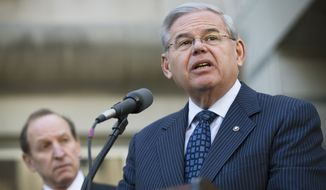 U.S. Sen. Bob Menendez speaks outside federal court, Thursday, April 2, 2015, in Newark, N.J. Menendez, the top Democrat on the U.S. Senate Foreign Relations Committee, was indicted on corruption charges, accused of using his office to improperly benefit an eye doctor and political donor. (AP Photo/John Minchillo)