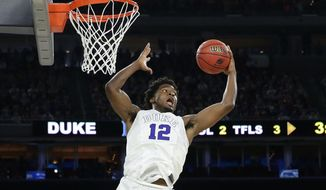 FILE - In this March 29, 2015, file photo, Duke's Justise Winslow (12) grabs a rebound against Gonzaga during the second half of a college basketball regional final game in the NCAA Tournament  in Houston. Winslow has speed and outside shot to play on the perimeter but the freshman also has the strength and bulk to match up with bigger forwards. And he's having a huge NCAA tournament for Duke, which arrives at the Final Four two wins from Mike Krzyzewski's latest national title. (AP Photo/Charlie Riedel, FIle)