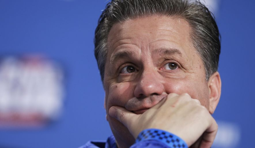 Kentucky head coach John Calipari listens to a question during a news conference for the NCAA Final Four tournament college basketball semifinal game Thursday, April 2, 2015, in Indianapolis. (AP Photo/Darron Cummings)