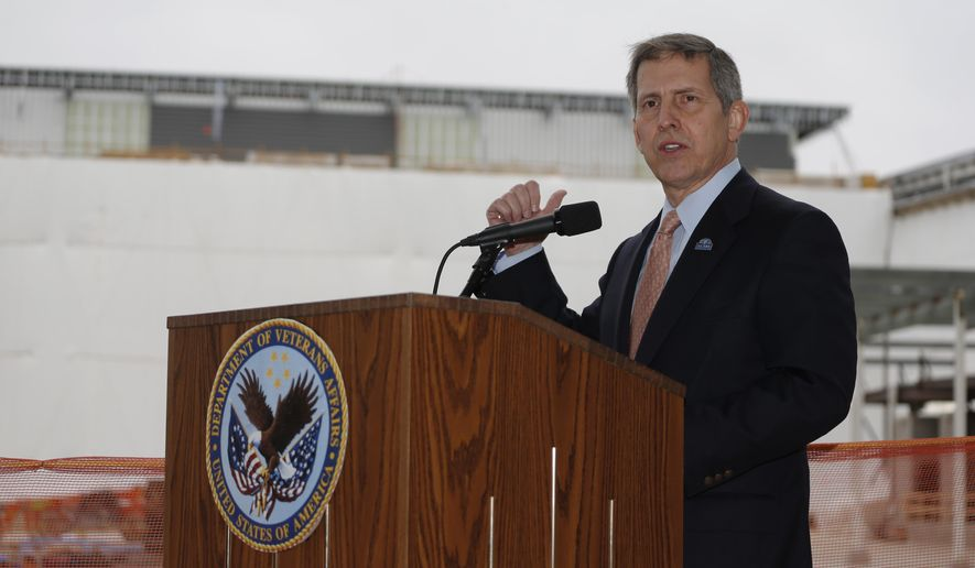 Sloan Gibson, deputy secretary of the department of U.S. Veterans Affairs, speaks during a news conference at the construction site of the Veterans Affairs hospital Thursday, April 2, 2015, in Aurora, Colo. Veterans Affairs officials are trying to get the overdue, over-budget hospital back on track. (AP Photo/David Zalubowski)