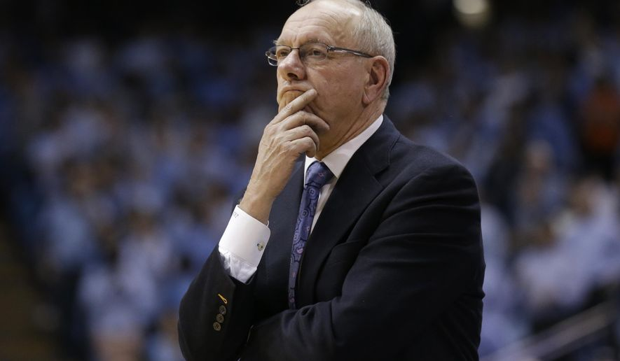 FILE - In this Jan. 26, 2015, file photo, Syracuse coach Jim Boeheim watches during his team's NCAA college basketball game against North Carolina in Chapel Hill, N.C. Syracuse was put on probation for five years and Boeheim got a nine-game suspension for violations that included failure to adhere to a drug-testing program that was deemed too confusing by school administrators. The NCAA recommends schools adopt their own drug policies but can then sanction schools for not following them. (AP Photo/Gerry Broome), File