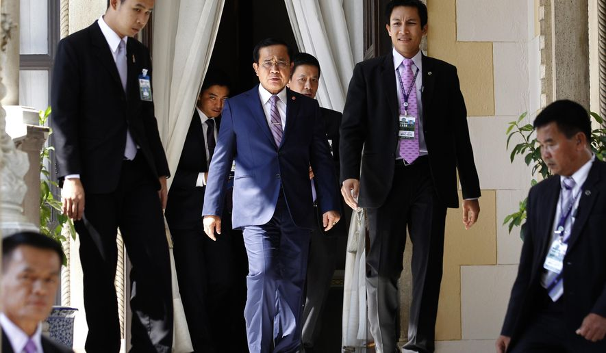 "Thailand's Prime Minister Prayuth Chan-ocha, center, arrives at Government House in Bangkok, Thailand, Thursday, April 2, 2015. Thailand's junta lifted martial law, which was imposed in the run-up to their May 22, 2014, coup -- but then quickly replaced it with another set of draconian laws innocuously called ""Article 44."" But make no mistake -- 10 months after staging the coup, a military junta is still ruling Thailand, essentially with absolute power. (AP Photo/Sakchai Lalit)"
