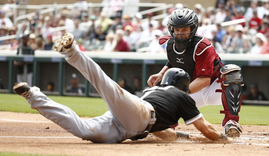 Arizona Diamondbacks catcher Tuffy Gosewisch tags out Chicago White Sox Adam Eaton in the first inning during a spring training exhibition baseball game, Thursday, Apr. 2, 2015 in Scottsdale, Ariz. (AP Photo/The Arizona Republic, Rob Schumacher)  MARICOPA COUNTY OUT; MAGS OUT; NO SALES