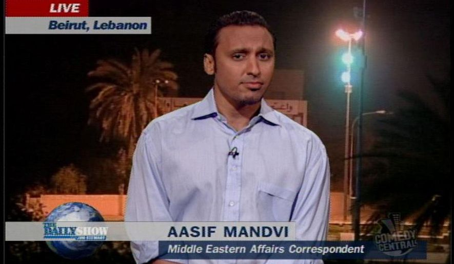 "This photo provided by Comedy Central shows actor Aasif Mandvi in a scene from ""The Daily Show"" on Comedy Central. ""The Daily Show"" correspondent Mandvi's sitcom parody targeting anti-Muslim bias will debut on the ""Funny or Die"" website April 9, 2015. (AP Photo/Comedy Central)"