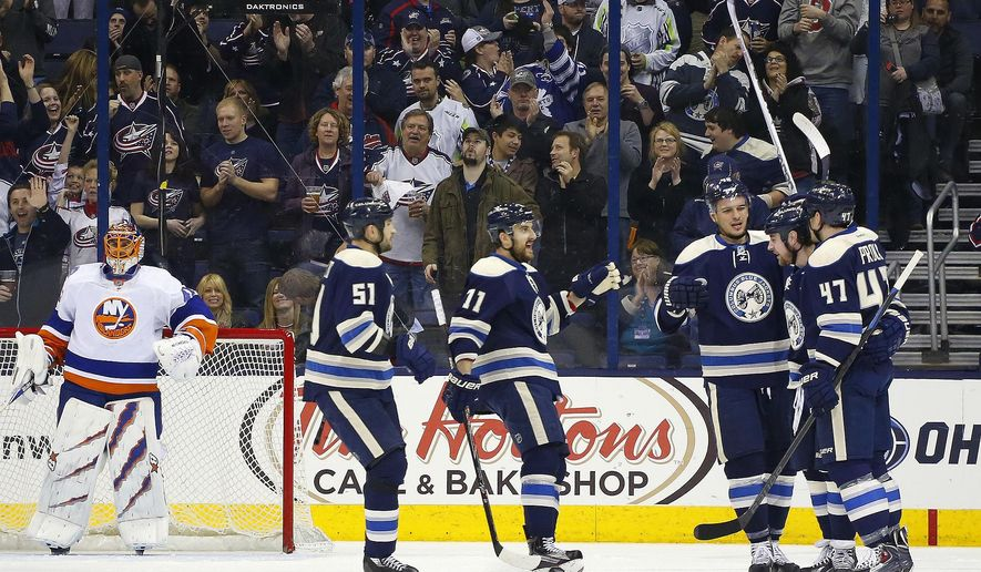 Columbus Blue Jackets' Brandon Dubinsky (17), second from right, celebrates with teammates after scoring against New York Islanders goalie Jaroslav Halak (54), of Slovakia, in the first period of an NHL hockey game, Thursday, April 2, 2015, in Columbus, Ohio. (AP Photo/Mike Munden)
