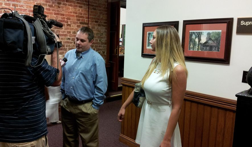 In a June 2013 photo, Joshua Malatino and Amanda Scott speak to the media Monday, March 30, 2015, after learning they won't be getting a permit to operate their Sno Kone Joe ice cream vending business in the city of Gloversville, N.Y., that summer. The charges against Malatino were dismissed Monday, March 30, 2015, in Gloversville City Court by acting Judge Howard Aison after a bench trial. Malatino and partner Amanda Scott, who owned the Sno Kone Joe business, were accused in April 2013 by a driver of a competitor Mr. Ding-a-Ling ice cream truck of trying to run his rival out of Gloversville, N.Y. (AP Phoro/The Daily Gazette, Edward Munger Jr.)