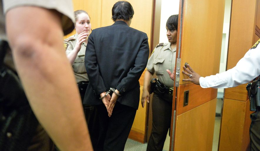 Former Deerwood Academy assistant principal Tabeeka Jordan is led to a holding cell after a jury found her guilty in the Atlanta Public Schools test-cheating trial, Wednesday, April 1, 2015, in Atlanta. Jordan and 10 other former Atlanta Public Schools educators accused of participating in a test cheating conspiracy that drew nationwide attention were convicted Wednesday of racketeering charges. (AP Photo/Atlanta Journal-Constitution, Kent D. Johnson, Pool)