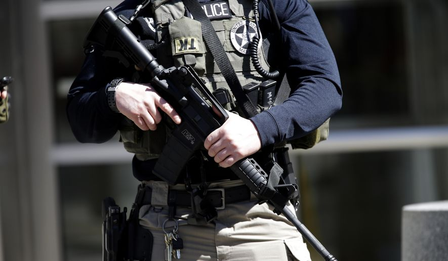 Heavily armed U.S. Marshals stand guard outside federal court Thursday, April 2, 2015, in the Brooklyn borough of New York. (AP Photo/Mary Altaffer) ** FILE **