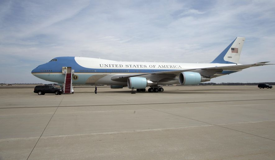 Air Force One awaits President Barack Obama on the tarmac at Andrews Air Force Base, Md., Thursday, April 2, 2015, for his trip to Louisville, Ky. The president delayed his departure for the trip because of the Iran nuclear talks in Switzerland, and to speak in the Rose Garden. But he's going ahead with the visit.  (AP Photo/Manuel Balce Ceneta)