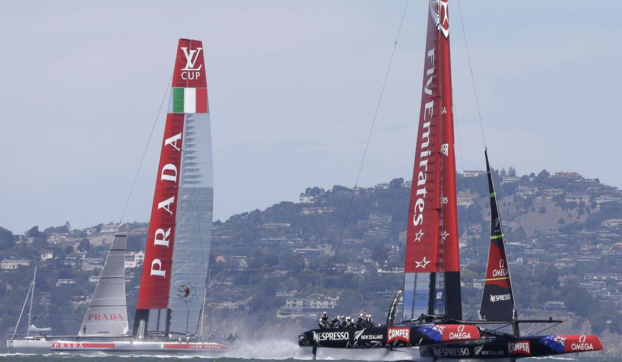 """In this Aug. 24, 2013 file photo Emirates Team New Zealand, right, and Luna Rossa Challenge, left, of Italy maneuver at the start of the seventh race of their America's Cup challenger series final sailing event  Saturday, Aug. 24, 2013, in San Francisco. Italian team Luna Rossa has announced Thursday, April 2, 2015 it will withdraw from the America's Cup after teams voted to reduce the size of boats to be sailed in the 2017 regatta in Bermuda. Luna Rossa said last week it """"will be obliged to withdraw"""" if the race boat was downsized. Team New Zealand supported the Italians. (AP Photo/Eric Risberg, File)"""