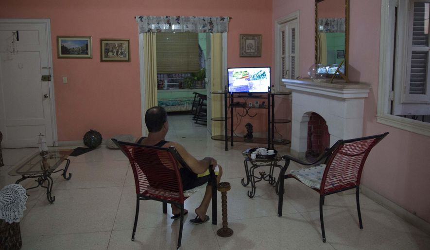 A home owner sits in his living room at his home with rooms for rent in Havana, Cuba, Wednesday, April 1, 2015. The wildly popular online home-sharing service Airbnb will allow American travelers to book lodging in Cuba starting Thursday in the most significant U.S. business expansion on the island since the declaration of detente between the two countries late last year. (AP Photo/Desmond Boylan)