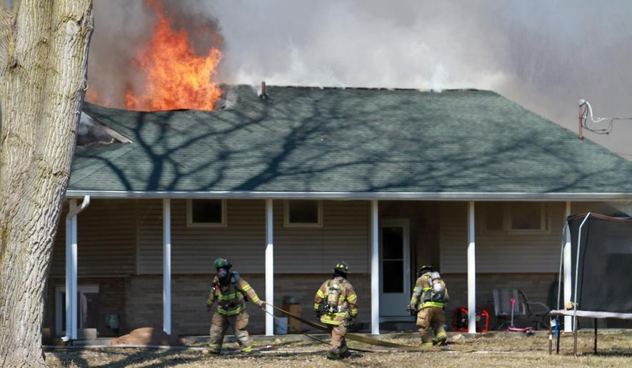 First responders were called to a house fire on 5190 Page Avenue in Leoni Township, Mich., on Wednesday, April 1, 2015. Authorities say two children and an adult are dead following the fire. (AP Photo/The Jackson Citizen Patriot, Brian J. Smith ) ALL LOCAL TELEVISION OUT; LOCAL TELEVISION INTERNET OUT