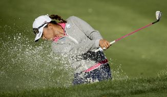 Lydia Ko, of New Zealand, hits out of the bunker on the 13th hole during the first round of the LPGA Tour ANA Inspiration golf tournament at Mission Hills Country Club on Thursday, April 2, 2015, in Rancho Mirage, Calif. (AP Photo/Chris Carlson)