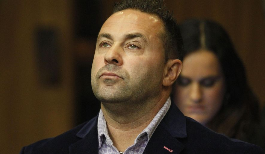 "FILE - In this Oct. 15, 2014 file photo, Giuseppe ""Joe"" Giudice, from the television show ""Real Housewives of New Jersey"", stands during a hearing in the Passaic County Courthouse in Paterson, N.J.  Giudice lost his driver's license for two years as he's preparing to head to federal prison for bankruptcy fraud. A state judge on Thursday, April 2, 2015, called Giudice's driving record the worst he's ever seen. He also fined Giudice the maximum $10,000. Giudice pleaded guilty in October to unlawful use of an ID and impersonation. (AP Photo/The Star-Ledger, William Perlman, Pool)"