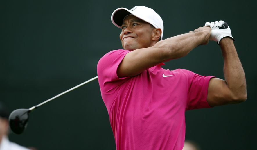 "FILE - In this Jan. 29, 2015, file photo, Tiger Woods tees off on the 17th hole during the first round of the Phoenix Open golf tournament in Scottsdale, Ariz. Tiger Woods has made up his mind _ he will play the Masters. After two trips to Augusta National this week, Woods announced his return to competition on his website Friday, April 3, 2015. He wrote: ""I'm playing the Masters. It's obviously very important to me, and I want to be there.""(AP Photo/Rick Scuteri, File)"