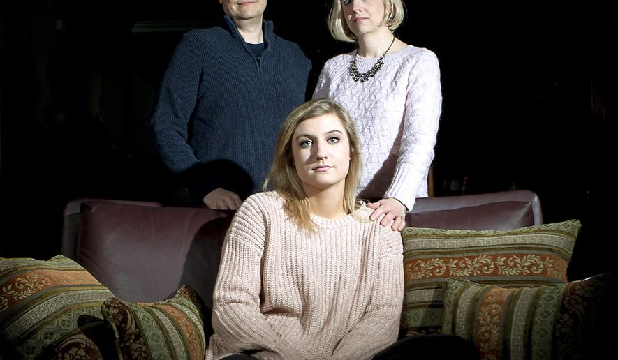 In this Feb. 19, 2015 photo, Katie Rajterowski, 18, sits with her parents Mike and Lynette Rajterowski at their home in Sycamore, Ill. Rajterowski has shared her story about an ex-boyfriend who was physically and verbally abusive before he threatened her life last June. She is starting a domestic violence awareness club at Sycamore High School after using counseling services at Safe Passage, a domestic violence and sexual assault agency that serves DeKalb County. (AP Photo/Daily Chronicle, Danielle Guerra)  CHICAGO TRIBUNE OUT, MANDATORY CREDIT