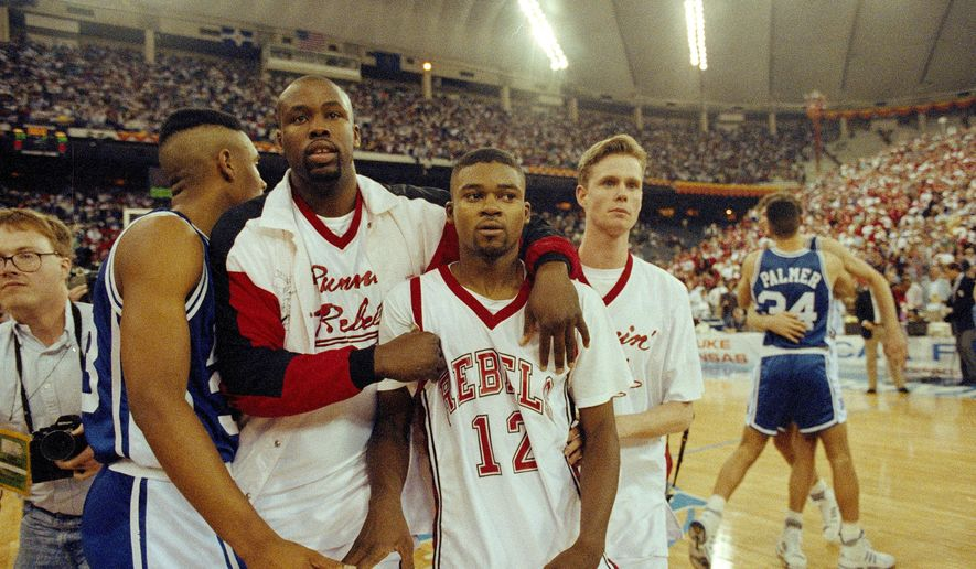 FILE - In this March 30, 1991, file photo, UNLV's Anderson Hunt (12) and unidentified teammates leave the floor after losing to Duke in the NCAA national semifinal game in Indianapolis. Anderson Hunt missed a shot he didn't want to take and, just like that, UNLV's unbeaten season ended. Unlike Kentucky those Runnin' Rebels had issues to deal with off the court as they chase a second straight championship. (AP Photo/Al Behrman, File)