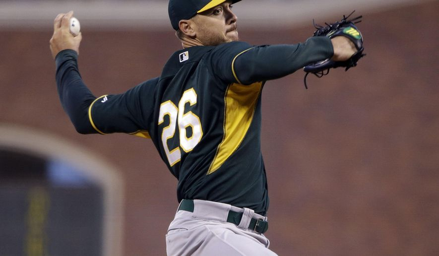 Oakland Athletics starting pitcher Scott Kazmir throws to the San Francisco Giants during the first inning of an exhibition baseball game Thursday, April 2, 2015, in San Francisco. (AP Photo/Marcio Jose Sanchez)