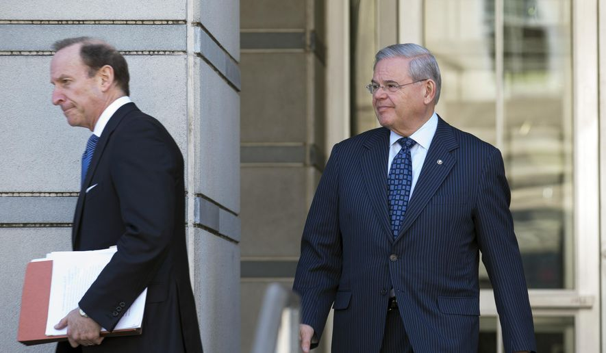 U.S. Sen. Bob Menendez, right, leaves federal court, Thursday, April 2, 2015, in Newark, N.J. Menendez, the top Democrat on the U.S. Senate Foreign Relations Committee, was indicted on corruption charges, accused of using his office to improperly benefit an eye doctor and political donor. (AP Photo/John Minchillo)