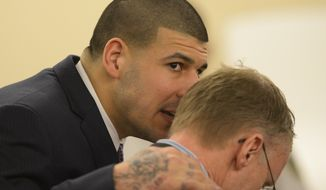 Former New England Patriots football player Aaron Hernandez talks with his attorney Charles Rankin during his murder trial at the Bristol County Superior Court in Fall River, Mass., on Friday, April 3, 2015. Hernandez is charged with killing Odin Lloyd. (AP Photo/CJ Gunther, Pool) ** FILE **