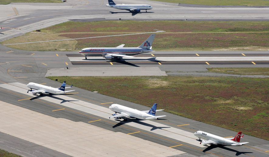 Planes taxi on runways at John F. Kennedy International Airport in New York in this Sept. 8, 2008, file photo. (AP Photo/Mark Lennihan, File)