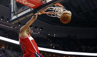 Washington Wizards forward Otto Porter Jr. (22) dunks the ball in the second half of an NBA basketball game against the New York Knicks, Friday, April 3, 2015, in Washington. The Wizards won 101-87. (AP Photo/Alex Brandon)