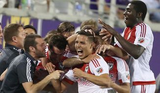 D.C. United's Luis Silva, center, celebrates with teammates after he scored the winning goal during an MLS soccer match against Orlando City, Friday, April 3, 2015 in Orlando, Fla. (AP Photo/Orlando Sentinel, Stephen M. Dowell) MAGS OUT; NO SALES