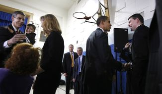 In December, 2008, President-elect Obama and Education Secretary-designate Arne Duncan, left, mingle at Chicago's Dodge Renaissance Academy. Incoming White House chief of staff Rahm Emanuel, center, looks on.  (AP Photo)