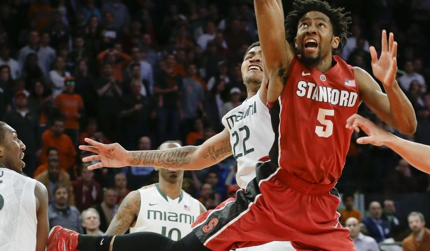 Stanford's Chasson Randle (5) drives past Miami's Omar Sherman (22) during the second half of the championship game at the NIT college basketball tournament Thursday, April 2, 2015, in New York. Stanford won 66-64 in overtime. (AP Photo/Frank Franklin II)