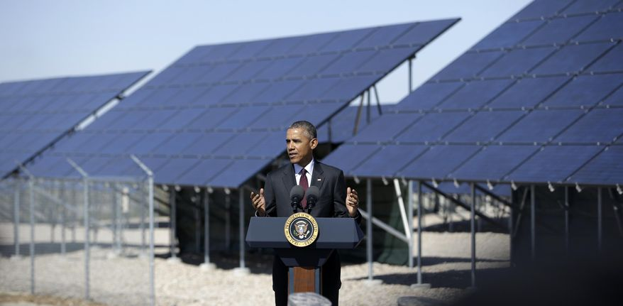President Barack Obama speaks about clean-energy jobs, Friday, April 3, 2015, at Hill Air Force Base, Utah. The speech followed a roundtable discussion Obama had with officials at the base about clean energy. (AP Photo/Rick Bowmer)