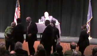 Republican Gov. Paul LePage abruptly ended a town hall meeting Thursday night after Joanne Twomey, former Democratic mayor of Biddeford, hurled a jar of Vaseline toward him. (YouTube)